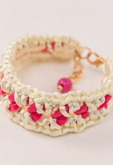 Handmade knitted bracelet from ivory satin cord and fuchsia plastic chain