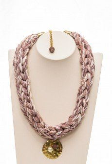 Handmade knitted necklace from yarn with central handmade circle element