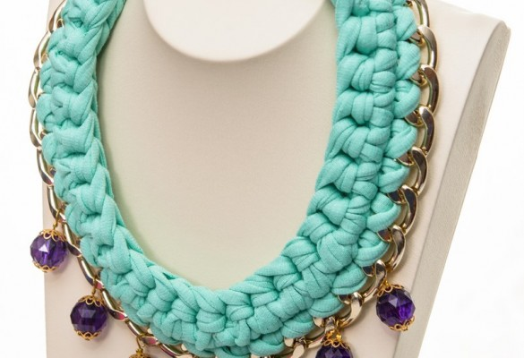 Handmade knitted statement necklace from fabric cord with gold tone chain and plastic purple embelishment beads